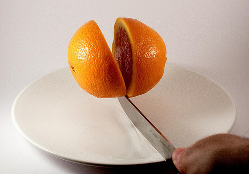 Knife cutting orange