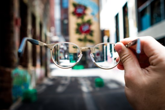 Looking through someone's glasses at a street scene